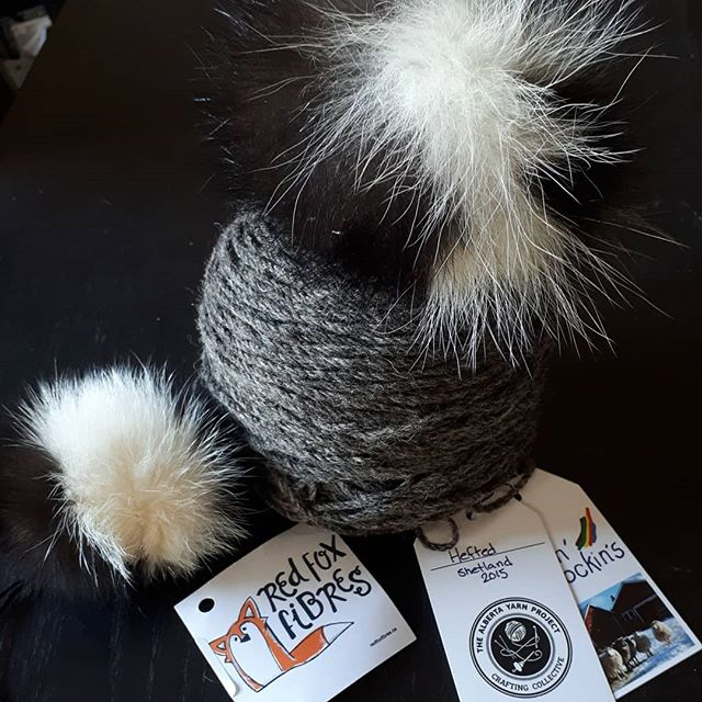 """Jason picked two yarns at Fibre Shindig, both in his favourite """"colour"""". This is the first, from @ABYarnProject and it shall be a most manly toque, topped with a @redfoxfibrescanada pom pom made from a common varmint in my 'hood, skunk. The Kid will have a matching pom but prefers much brighter colours in his headwear. I love Shindig so much - what fun comes out of it!.#buyhandmade #skunkpompom #yarn #AlbertaMade #madeinAlberta - from Instagram"""